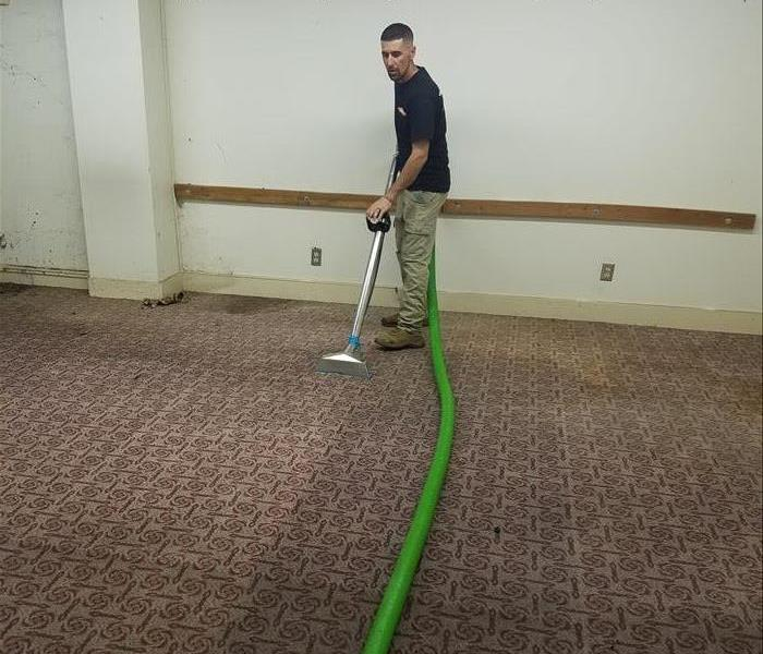 SERVPRO team member extracting water.