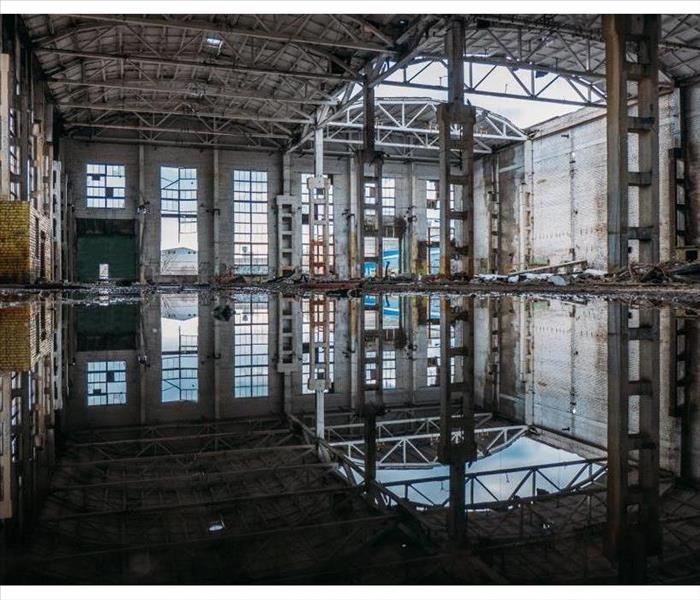 An empty building flooded by sewage water