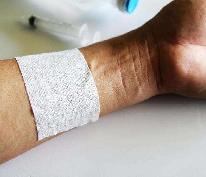 an arm with a bandage on it